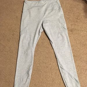 Grey activewear leggings with mesh/side pockets
